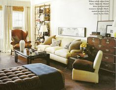 Billy Baldwin brass etagere, Campaign chest, tufted lounge with plain sofa, bamboo shades