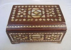 E Kenoz - Egyptian Antique Style Mother of Pearl Wood Jewelry Box, $99.00 (http://www.ekenoz.com/moroccan-home-decor/egyptian-antique-style-mother-of-pearl-wood-jewelry-box/)