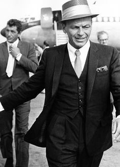Frank Sinatra and Dean Martin arrive in London, 1961.