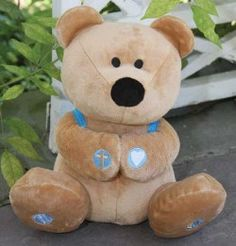 With childlike faith, Prayer Bear says 4 different prayers. Squeeze his paws to hear his trusting plea to God in Heaven, The Lord's Prayer, Mealtime Blessing, and Bedtime Prayer. Soft and sweet, Prayer bear comes with knapsack and prayer book. Amen.