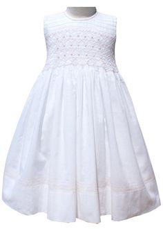 Girls special occasion white dress. Pastel pink roses on a background of white and pink smocking in a heart pattern. With a long sash 17372