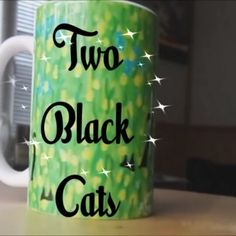 this video features 2 black cats on a coffee mug. The mug features a painting called 'Two Black Cats' and is available at the webshop. 🔊Sound on for added witchypoo effect.