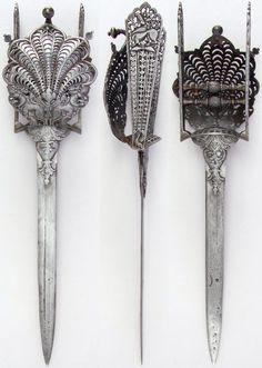 Indian hooded katar, 17th–18th century, European blade. Dimensions: L. 18 9/16 in. (47.1 cm); W. 4 1/2 in. (11.4 cm); Wt. 25.4 oz. (720.1 g), Met Museum.
