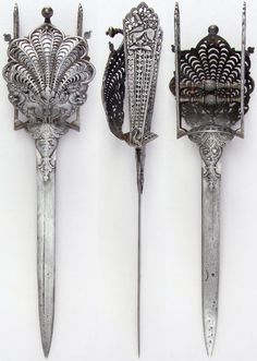 Indian hooded katar, with prominent peacocks, yali's (leogryphs) and fish, 17th to 18th century, European blade. Dimensions: L. 18 9/16 in. (47.1 cm); W. 4 1/2 in. (11.4 cm); Wt. 25.4 oz. (720.1 g), Met Museum. Bequest of George C. Stone, 1935.