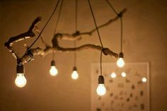 An old branch turned into a beautiful light fixture! Would look great on my back porch!!!