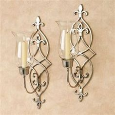 The Jonetia Satin Nickel Hurricane Wall Sconce Pair proudly displays grandeur on your walls. These hand-forged, solid brass sconces feature a diamond design. Sconces Living Room, Bathroom Wall Sconces, Candle Wall Sconces, Living Walls, Wall Decor Design, Metal Wall Decor, Metal Wall Art, Wall Candle Holders, Candle Stand