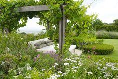 divine day bed under a vine covered pergola by Franchesca Watson | Garden Designer