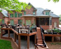 A good-sized deck... not really that extravagant. It just looks rich. Great design for a house with a walkout basement.