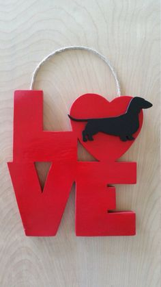 Doxie LOVE!  Dachshund Hanging Sign by askmeifiwood on Etsy https://www.etsy.com/listing/242662909/doxie-love-dachshund-hanging-sign