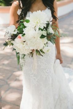 Bohemian dahlia, peony, ranunculus, rose and thistle wedding bouquet: http://www.stylemepretty.com/little-black-book-blog/2016/11/30/blue-bohemian-summer-california-wedding/ Photography: One Love - http://www.onelove-photo.com/