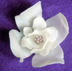 milk jug flower brooch