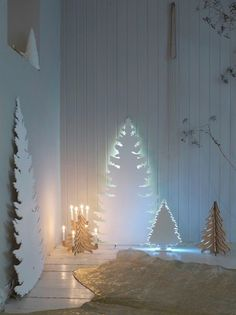 http://www.apartmenttherapy.com/creative-christmas-trees-for-the-space-challenged-180516