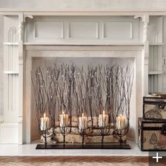 non working fireplace decor | perfect for the holidays a linear candelabra and lighted branches