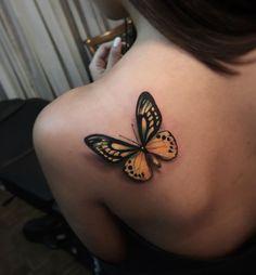 Magnificent butterfly tattoo by Alex Bruz