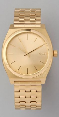 I would totally be into watches if this lovely was hanging round my wrist! Gold bling Nixon watch please