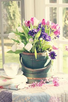 SUN SHINEY DAY - White and Purple Tulips with Dark Purple Flowers in a Wood Bucket, by Marla Starzyk