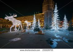 STOCKHOLM - 25 NOV: Christmas decorations in forms of a Moose family in the city centre of Stockholm. 25 November 2014, Sweden. Sergels torg during renovation