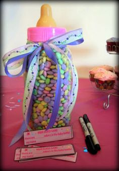 How many m&m's are in the baby bottle? Perfect little game for a baby shower. For all of your pre mommy products visit Beauty.com.