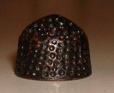14th-16th Century Beehive thimble, probably.
