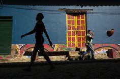 Girl walking through street of Raquira