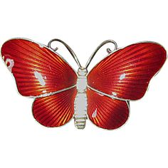 Ivar T. Holth This brilliant red butterfly pin is sterling silver from the Norwegian maker Ivar T. Holth of Oslo. The wings are striped red guilloche enamel; the  $110