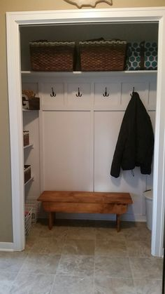 Coat closet turned into a mini mudroom - CAN I FIND A WAY TO HAVE THIS IN MY HOUSE NOW?