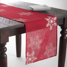 Bring a taste of the holidays with this runner/topper. Perfect for any tabletop, evoke a winter wonderland for your guests with this deep and festive runner/topper.