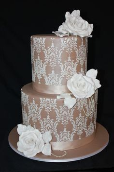 Simply Vintage   Two tier double barrel round design. Features mocha coloured fondant, ribbon, white stencilled lace design, large sugar roses, leaves and pearl strands. Cake finished with an all over pearlescent shimmer. Beautiful Cakes, Simply Beautiful, Double Barrel Cake, Mocha Color, Amazing Wedding Cakes, Take The Cake, Round Design, Cake Stands, Edible Art