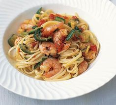 Shrimp zucchini linguine  olive oil  3 medium courgettes , halved lengthways and sliced  1 garlic clove, finely chopped  pinch dried chilli flakes  400g cooked peeled prawns  200g tin chopped tomatoes , drained of juice  finely chopped basil leaves  400g linguine