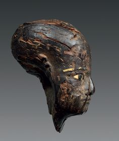 Head of a man.    Wood, calcite and gold.  Egypt,  Third Intermediary Period - Late Period
