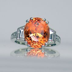Mandarin garnet and diamond ring in platinum