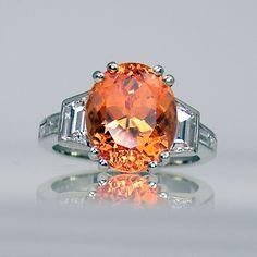 Mandarin garnet and diamond ring in platinum