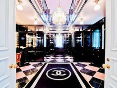 Every girl needs a Chanel bathroom! This looks more like a luxury beauty parlor than a master bath. Coco Chanel would be proud!         At The Champ d'Or Mansion #architecture #luxury #design #decor #French #Dallas #black #white #tile #chandelier