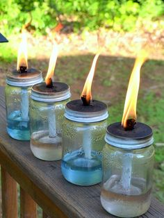 DIY these outdoor mason jar tiki torches for your next backyard party in just five minutes! You can make your own with a mason jar, oil and a wick. Mason Jar Projects, Mason Jar Crafts, Diy Projects, Solar Mason Jars, Bottles And Jars, Glass Jars, Candle Jars, Oil Candles, Beer Bottles