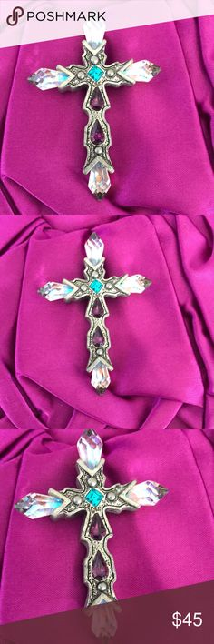 Silver cross with crystals Gorgeous silver cross with clear crystals and purple and green stones approximately 2  1/2 x  1  3/4 Jewelry Necklaces