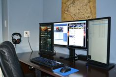 three monitor setup one large in middle two portrait on each side