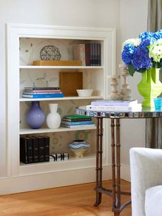 Give shelves a charming and cohesive look with an exciting backdrop by applying contact paper, scrapbook paper, or fabric to the back of a bookshelf. If you don't want to commit to a particular design or color scheme, measure the bookshelf's back panel and mount the background material on poster board, cut to the size of each shelf.