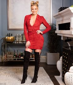 Sizzling: Khloe Kardashian wears a plunging red dress and thigh-high black boots for Wedne...