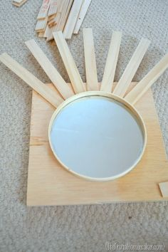 diy mirror art | DIY Sunburst Mirror {$4 wall art} | The Frugal Homemaker