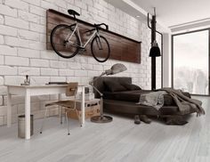 Wood Effect Floor Tiles in Hipster Loft Apartment with Bike Hanging on Wall
