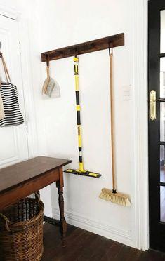 DIY broom rack - a timber peg rail to hang cleaning equipment.