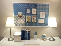 A patchwork of scrapbook paper can dress up the plain cork of your pin board. Choose colors and patterns that coordinate with your desk accessories.