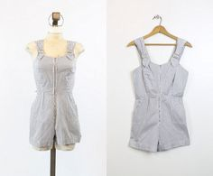 Super sweet 1940s romper! Done in a crisp striped cotton. Sweetheart neckline with front metal zip and overall straps with metal slide through