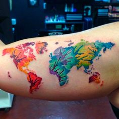 40 world map tattoos that will ignite your inner travel bug watercolor map tattoo yes gumiabroncs