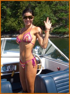Lisa Rinna wearing sequined crochet Beach Goddess bikini by Anna Kosturova
