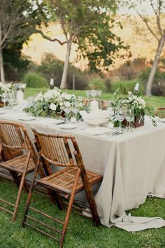 cream and sage tablescape bamboo chairs wedding
