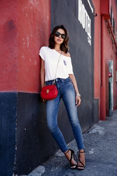 skinny jeans with one shoulder white top