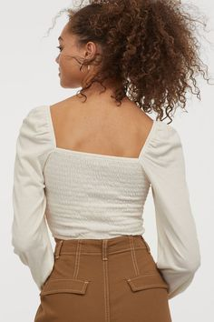 Cropped top in crêped jersey with a square neckline front and back. Smocked bodice long puff sleeves and concealed elastic at shoulders and cuffs. Magazine Man, Square Necklines, Fashion Company, Playing Dress Up, World Of Fashion, Smocking, Sleeve Styles, Bodice, Personal Style
