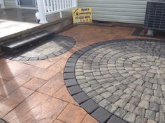 Nicolock Sante-Euro Circle Kit in Granite City Blend cut into Golden Brown Stone Ridge XL patio hardscape in Abbottstown, Pa by Ryan's Landscaping.