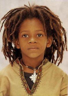 age: child Hair: brown, dreads, locs, dreadlocs skin: medium dark eyes: brown